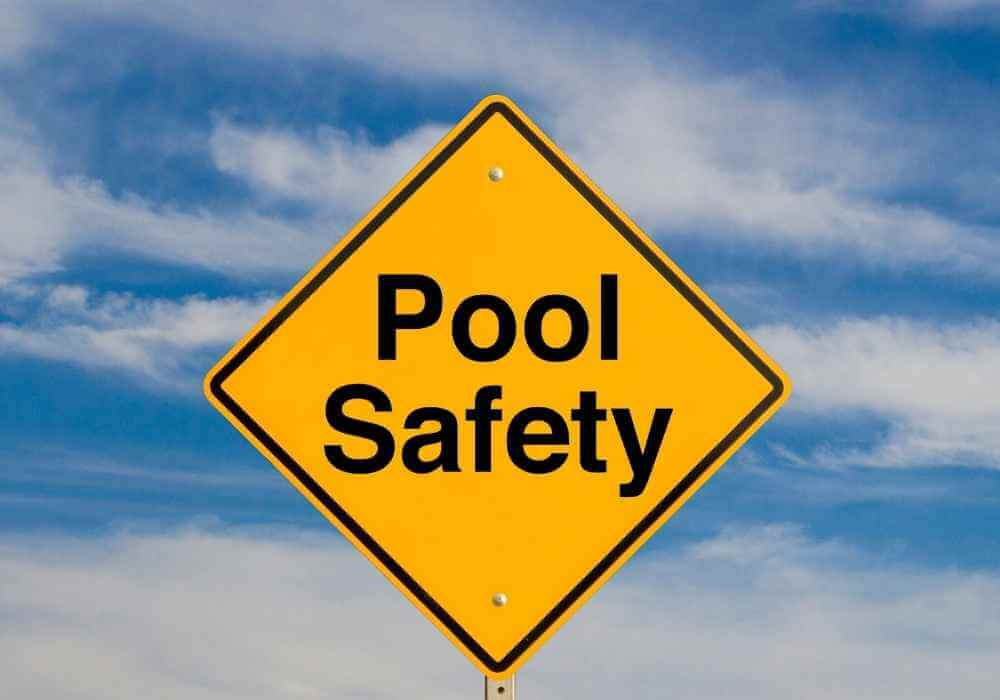 A Yellow Pool Safety Sign