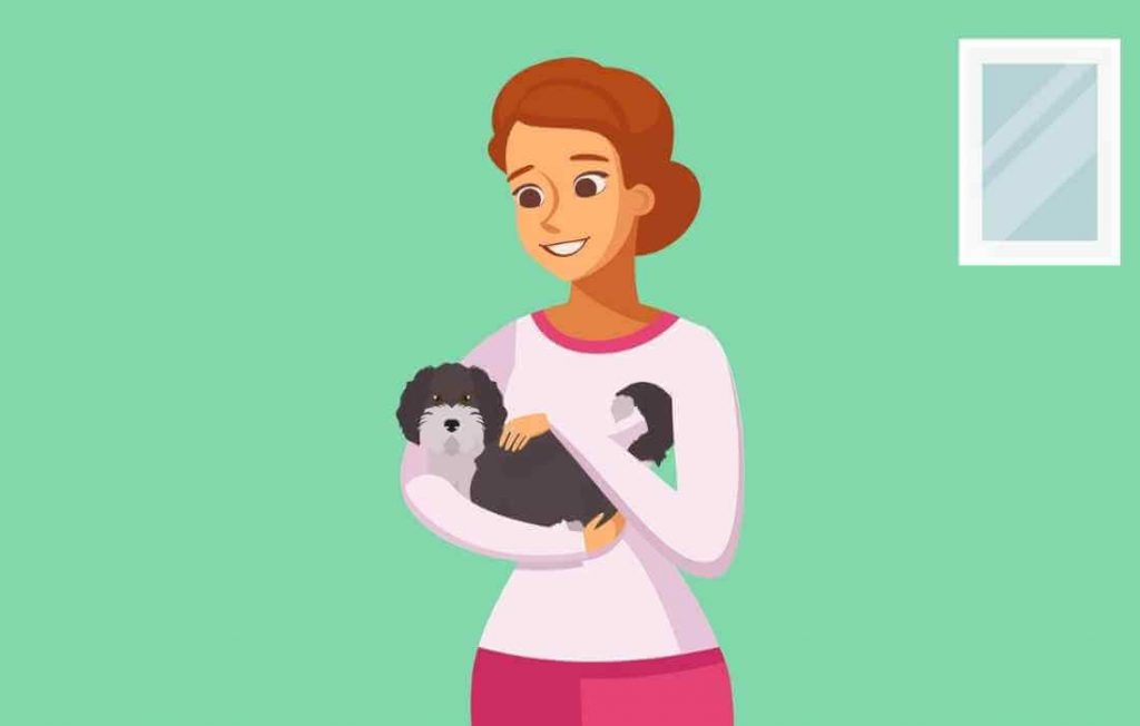 Woman holding a hypoallergenic aussiedoodle